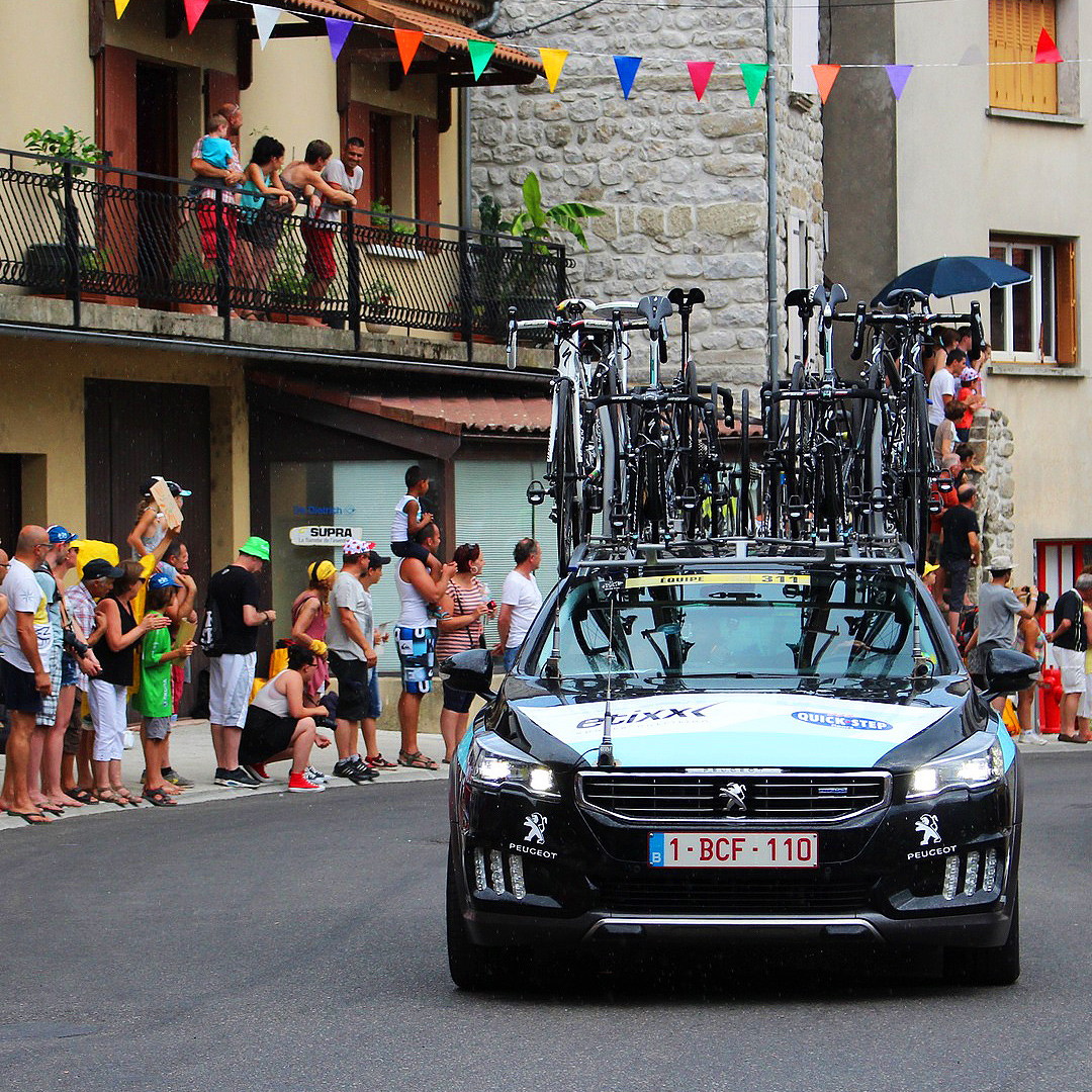 Tour de France support vehicle and crowds